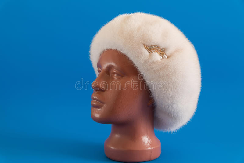 Pearly beret from natural mink on mannequin. Pearly beret from natural mink on a mannequin stock photos