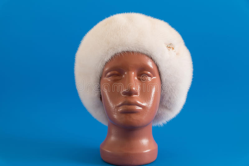 Pearly beret from natural mink on mannequin. Pearly beret from natural mink on a mannequin stock images