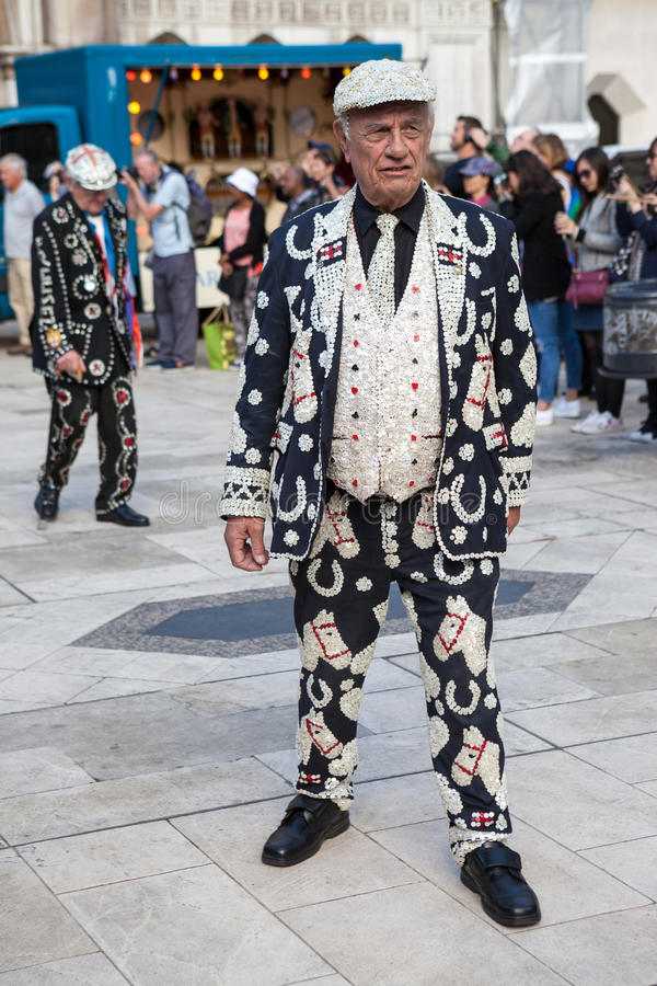 Pearly King, London. A Pearly King wearing clothes decorated with so-called pearl, actually mother-of-pearl buttons royalty free stock photo