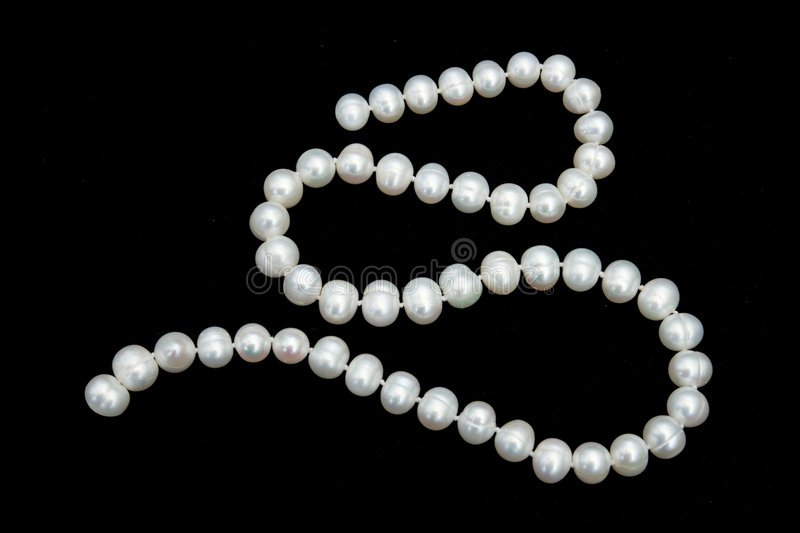 Pearly necklace. Isolated on black background stock image