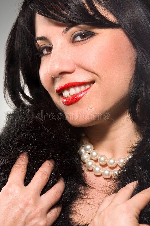 Pearly Smile. Smiling Brunette royalty free stock photos