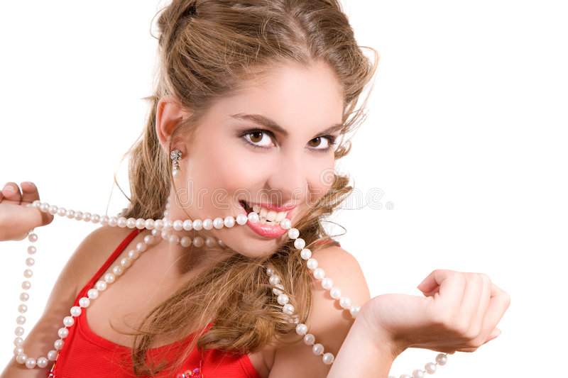 Pearly whites. Beautiful brunette with a string of pearls between her white teeth stock photos