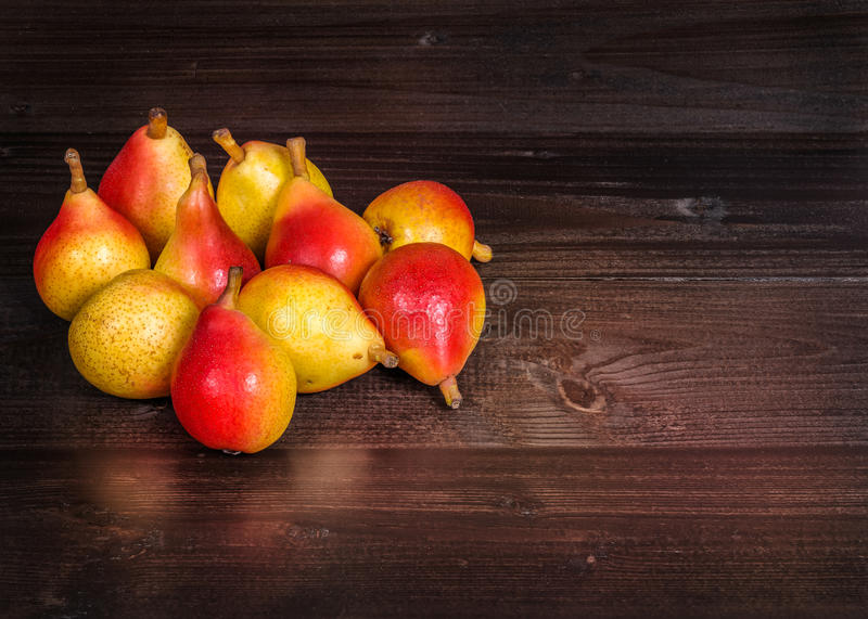 Pears Angelica. In the picture a set of pears Angelica Typical Italian, placed on wooden boards brown and empty space on the right royalty free stock image