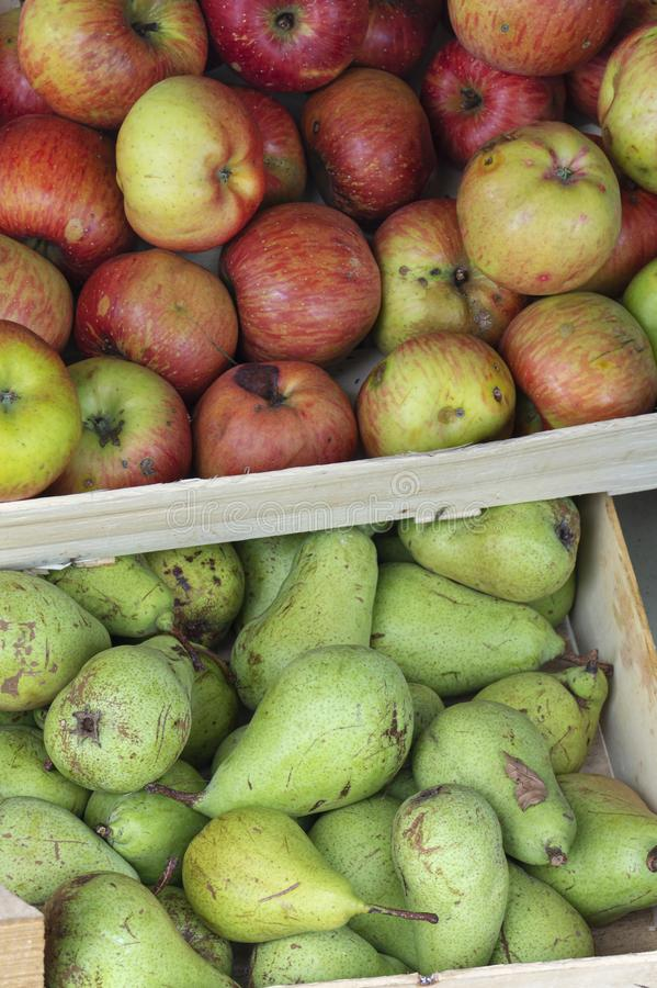 Pears and apples in wooden box. Close up stock photos