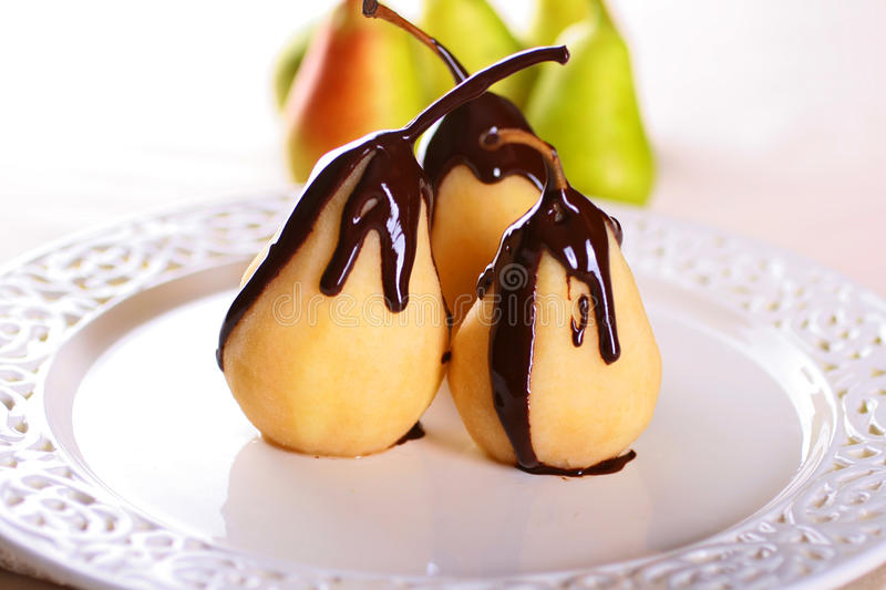 Pears in Chocolate. Poached Pears in hot Chocolate stock images