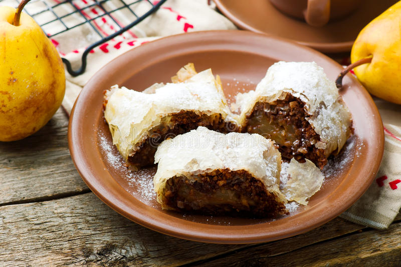 Pears and chocolate strudel. .selective focus. Style rustic stock photography