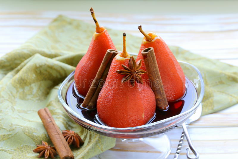 Pears cooked in wine with spices royalty free stock image