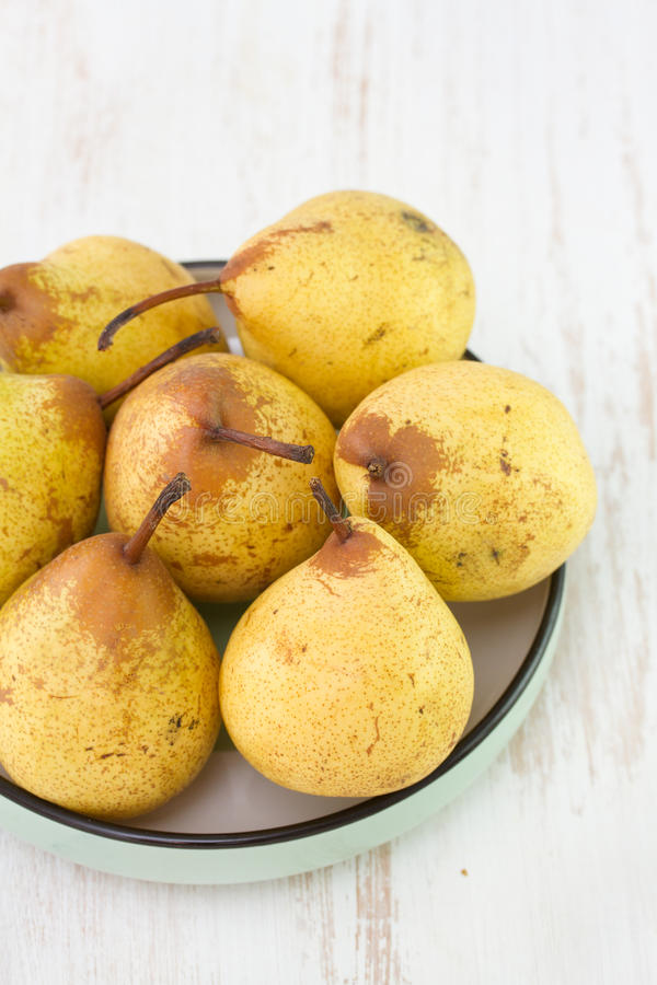 Pears in dish royalty free stock photo
