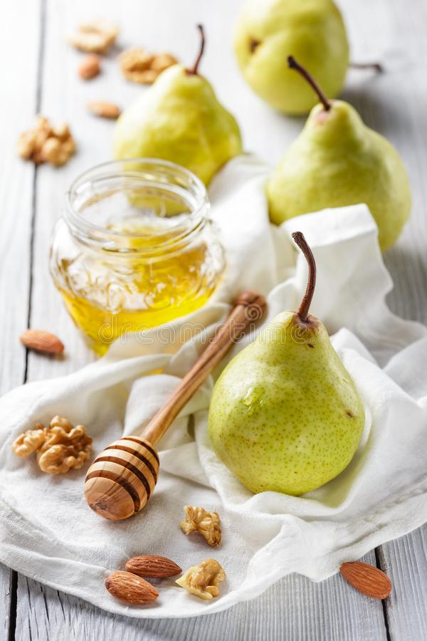 Pears with honey royalty free stock photography