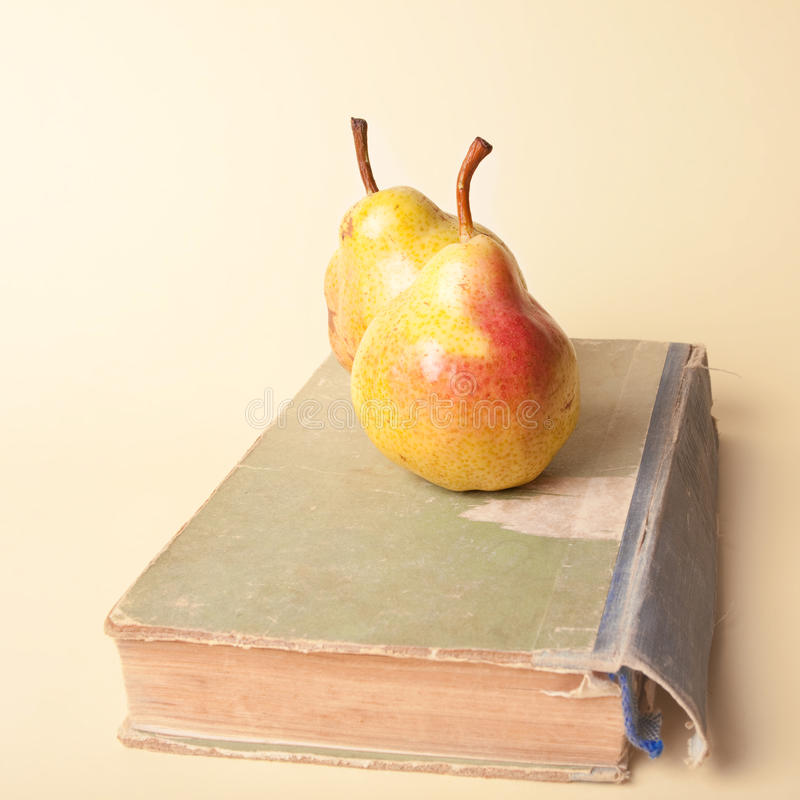 Pears And Old Book Stock Images