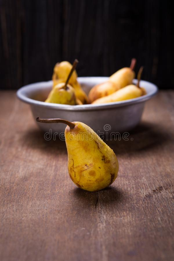 Pears in old dish royalty free stock photos