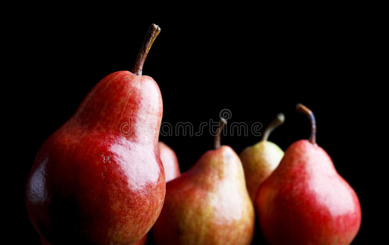 Pears over black background stock image