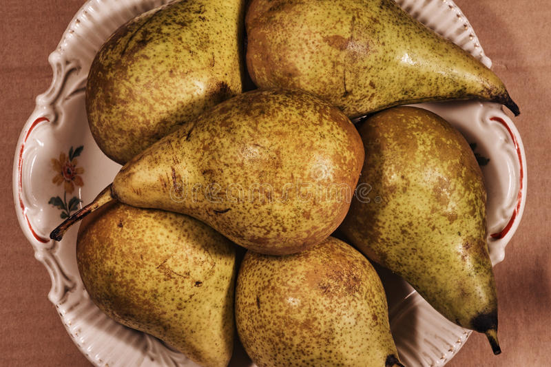 Pears on porcelain dish royalty free stock image