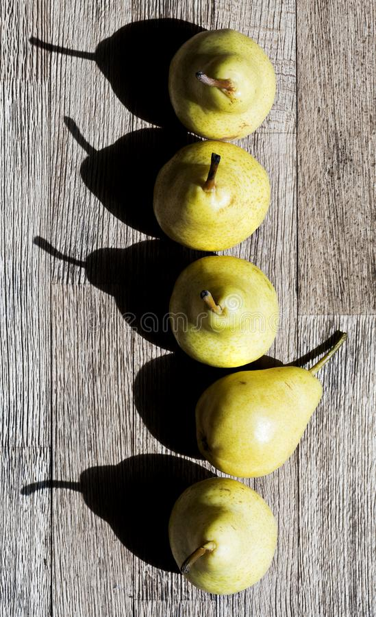 Pears in a row. Top view royalty free stock photography