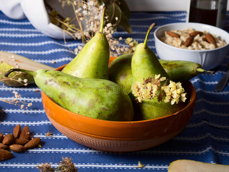 Pears on rustic background royalty free stock image