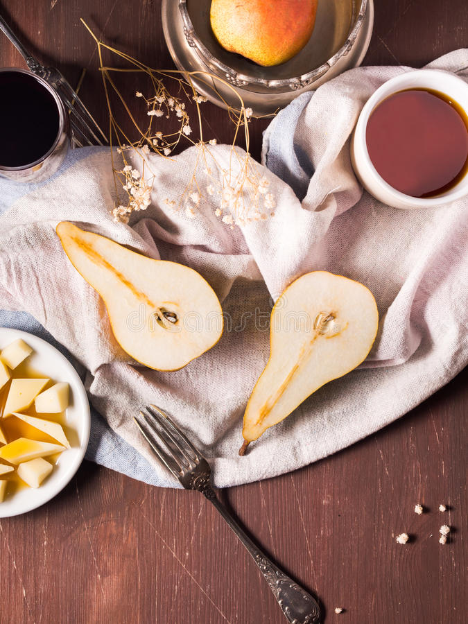 Pears on rustic background stock images
