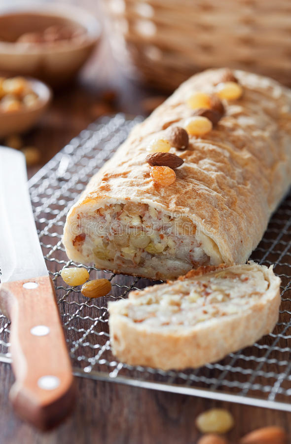 Pears strudel. With almonds and raisins. Selective focus royalty free stock photo