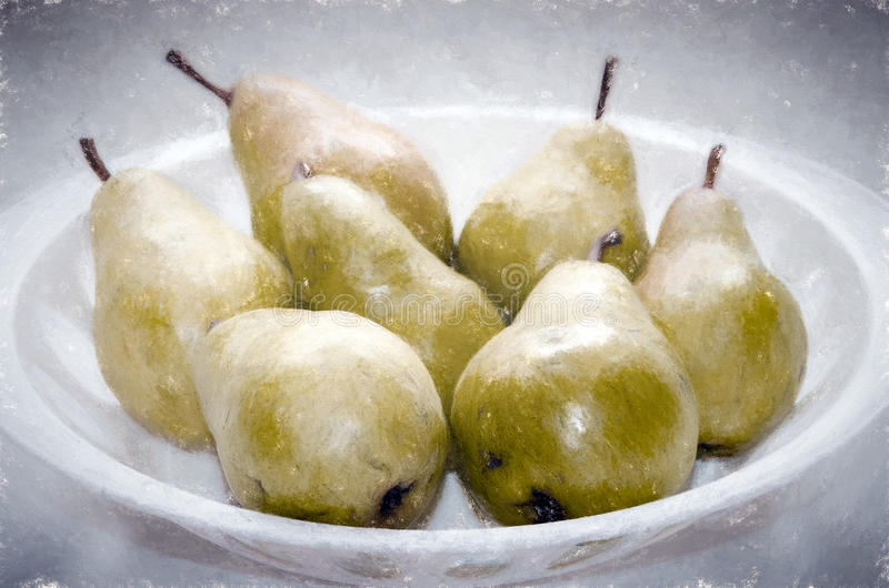 Pears in a white plastic bowl royalty free stock images