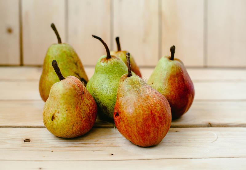 Pears on wood background stock photography