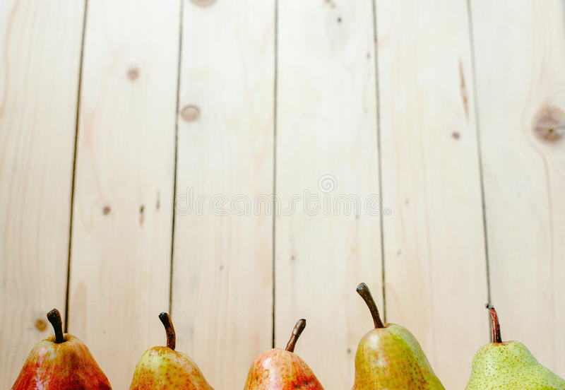Pears on wood background stock photo