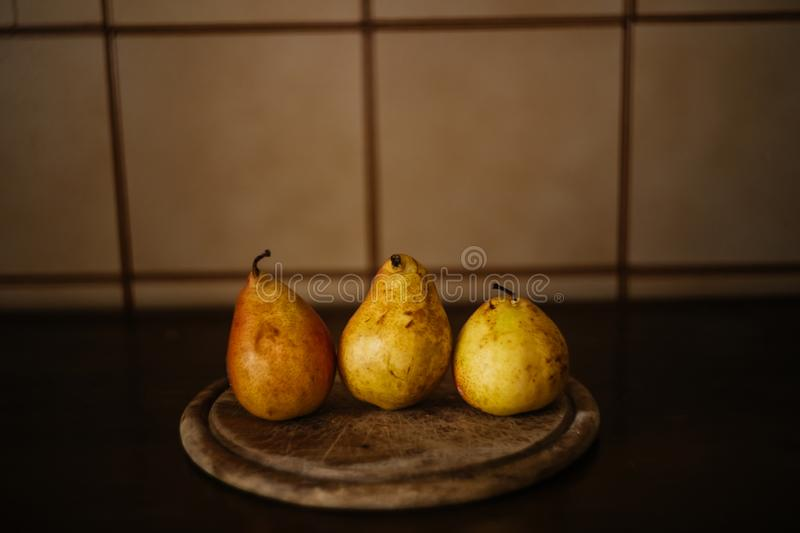 Pears on wooden table stock images