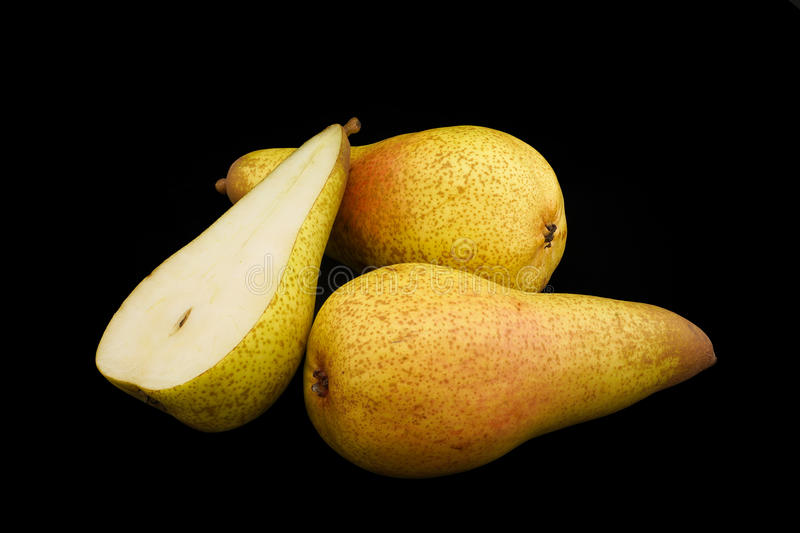 Pears of yellow color on a black background closeup. Option 3 royalty free stock image
