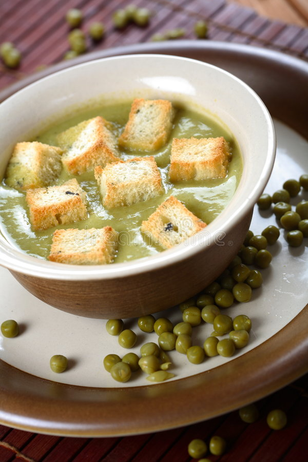 Peas soup with toast royalty free stock image