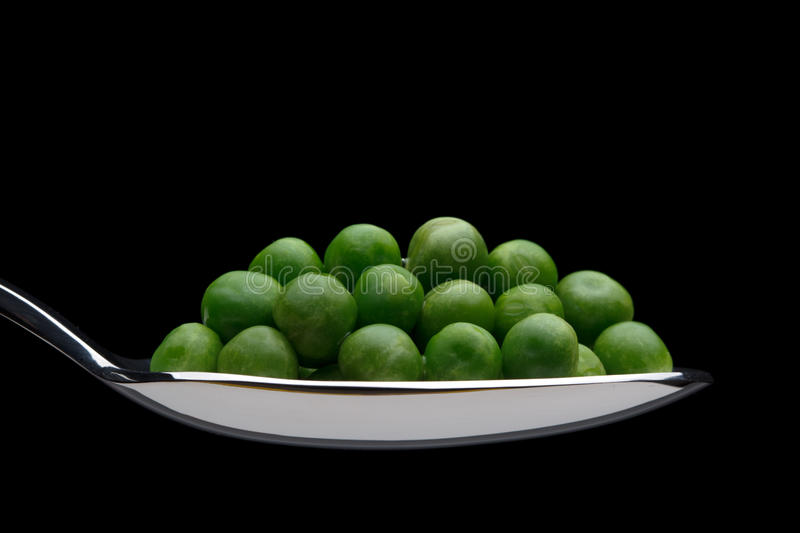Peas On A Spoon Stock Images
