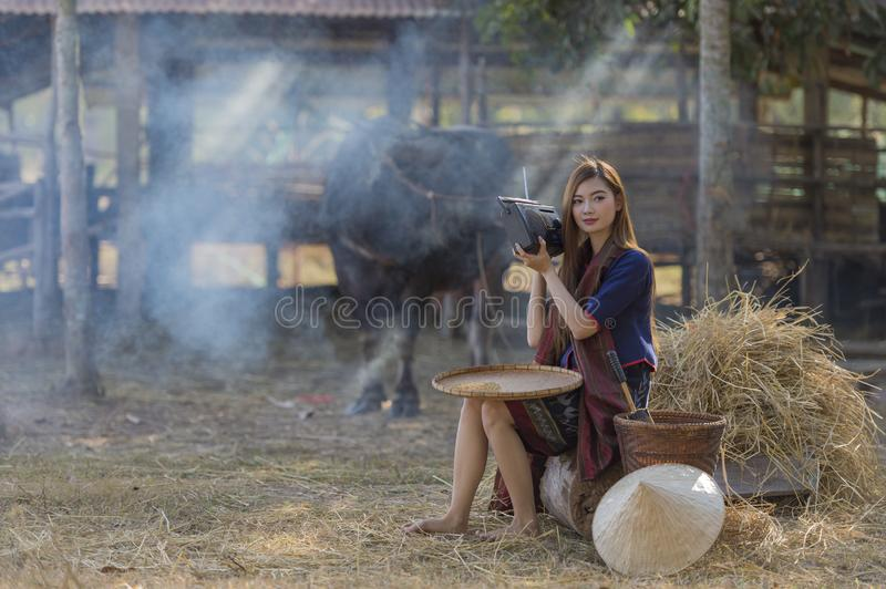 A peasant girl sitting listening to the radio on farm background stock photos