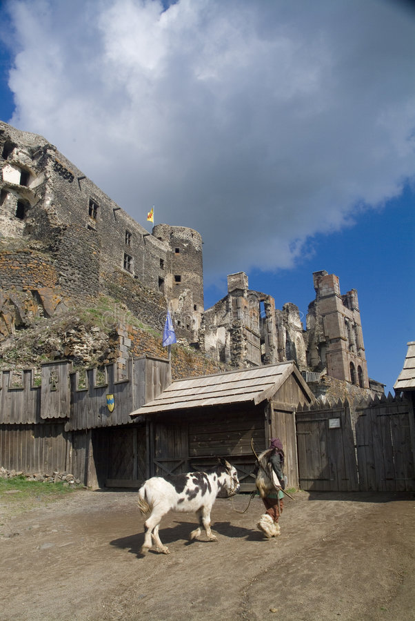 Peasant leading mule into castle royalty free stock photos