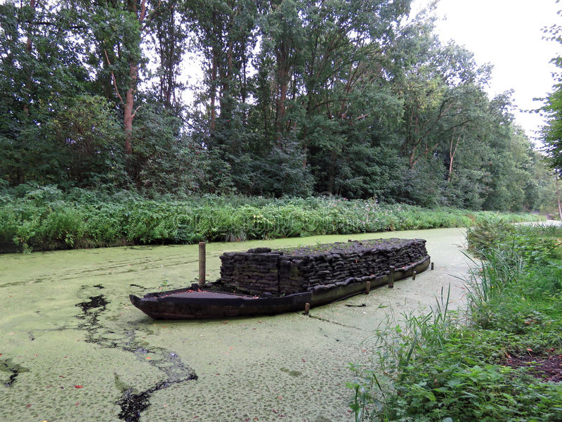 Peat boat in Veenhuizen. Peat barge in canal in Veenhuizen in the Netherlands royalty free stock image