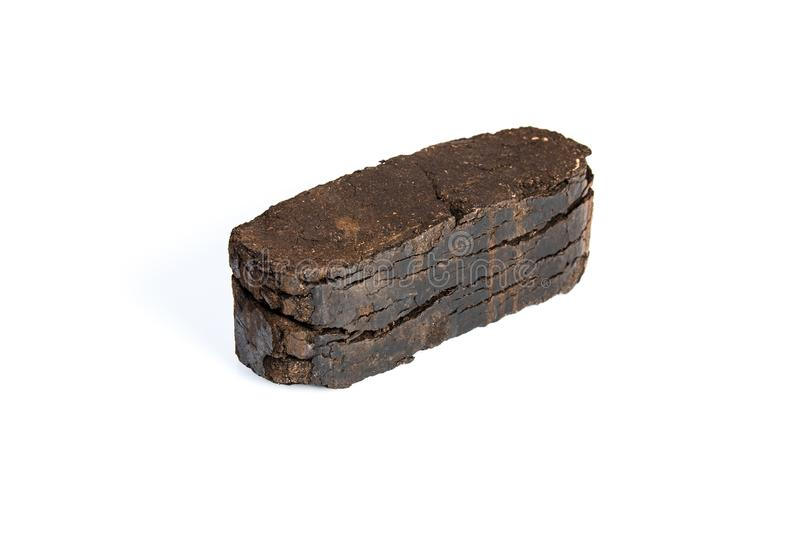 Peat briquette isolated on white background, alternative fuels. Raw material royalty free stock photos