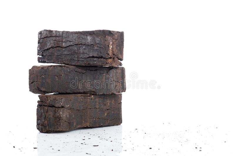 Peat briquettes on white background, alternative fuels, place for text royalty free stock image