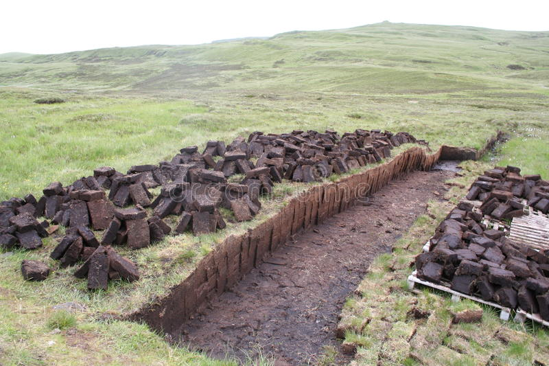Peat. A field was stabbed in Scotland on the peat stock photos