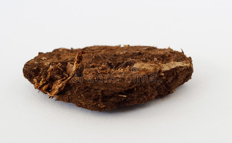 Peat mineral on white background. Potentially for economic fuel and energy markets prices news royalty free stock photo