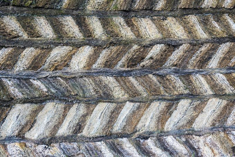 Peat structure of traditional Icelandic turf construction made of clamped blocks with strips between the layers royalty free stock photo