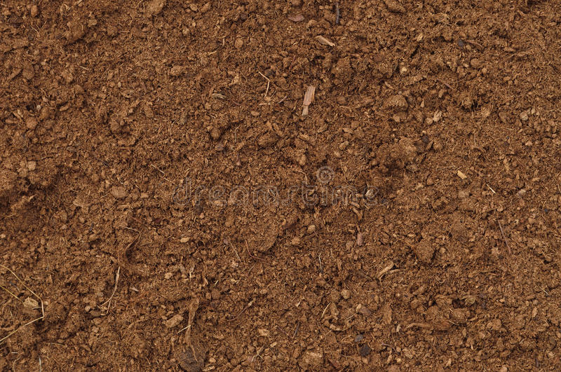 Peat Turf Macro Closeup, large detailed brown organic humus soil texture background pattern, horizontal textured copy space royalty free stock photography
