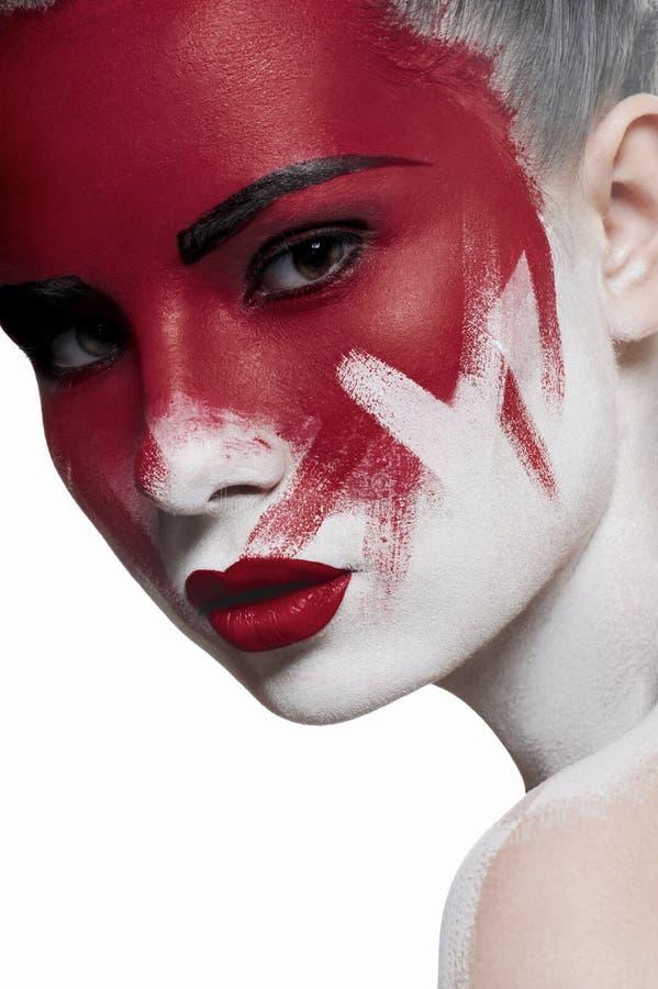 Peau blanche, lèvres rouges et sang sur le visage photos libres de droits