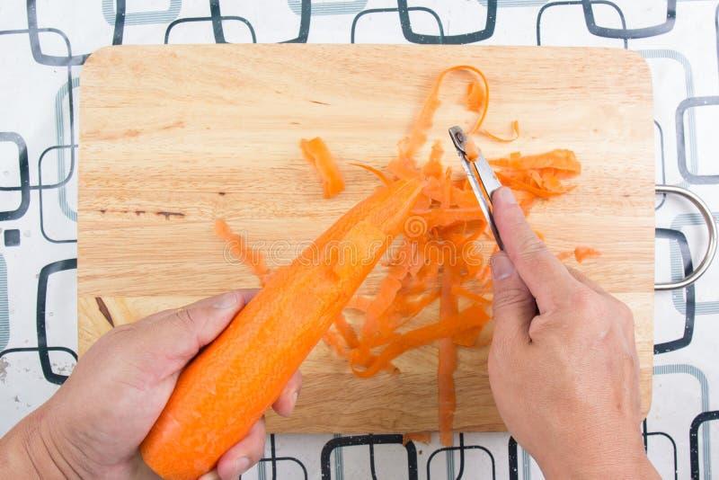 Peau de chef et carotte de côtelette images stock