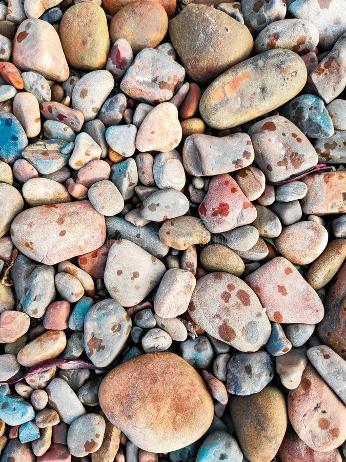Pebble beach background, stone floor. Abstract nature pebbles background. Sea peblles beach. Beautiful nature stock photo