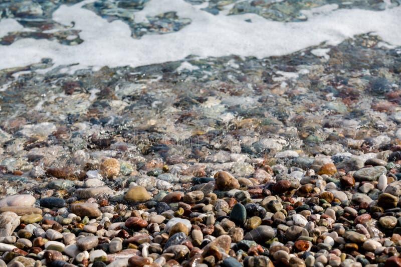 Pebble beach on the famous turkish Konyaalti Beach, Antalya, Turkey stock photography
