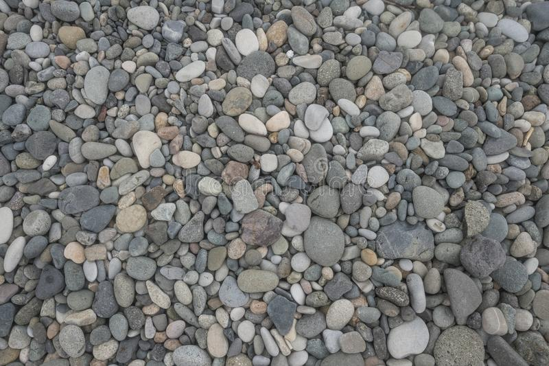 Pebble on beach on sunny day abstract pattern texture background royalty free stock image