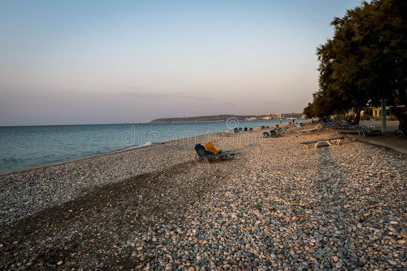 Pebble beach at sunset on the island of Rhodes royalty free stock photos