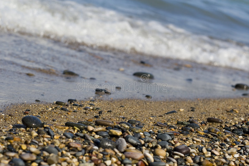 Pebble beach waves stock image
