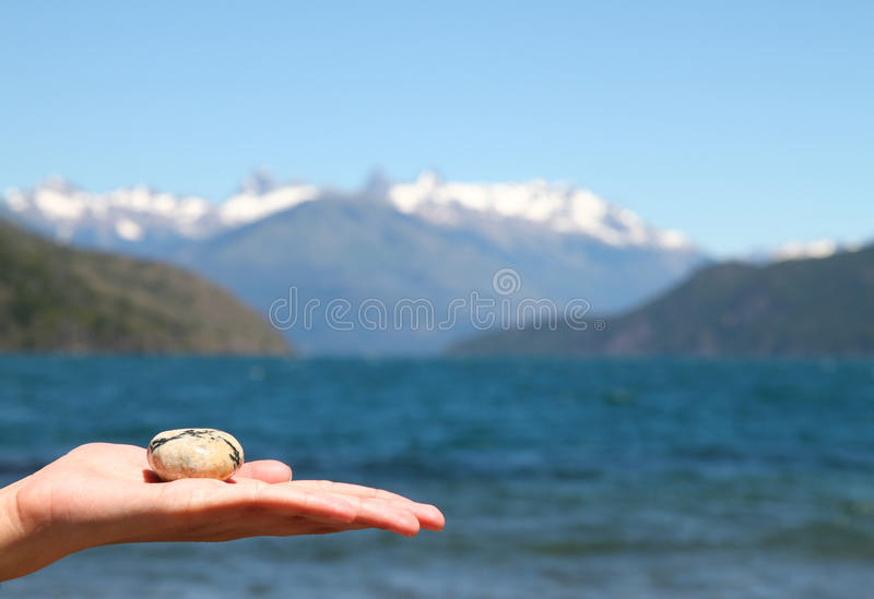 Download Pebble in the hand stock image. Image of brown, high - 14456809