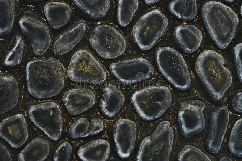 Pebble Path. Smooth Black Pebble Path Pattern royalty free stock image
