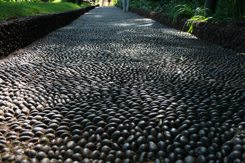 Pebble Path. A lovely pebble path laid out in a public garden, in Funchal. An example of skilful craftsmanship for the pleasure of others royalty free stock photography