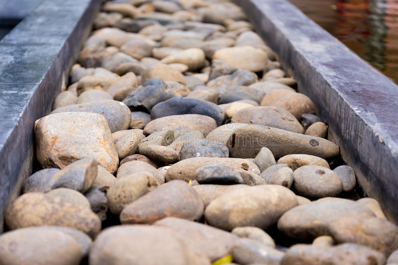 Pebble path. Straight pebble path on the edge of pond royalty free stock images