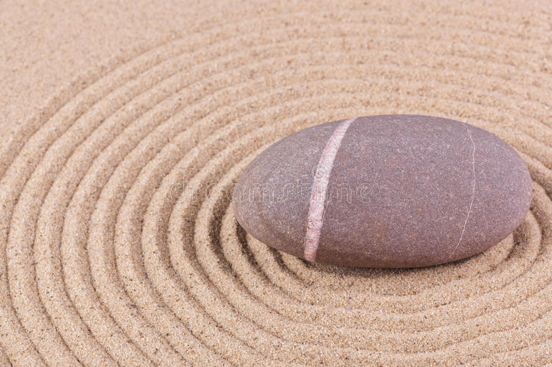 Pebble In A Raked Sand Circle Royalty Free Stock Image