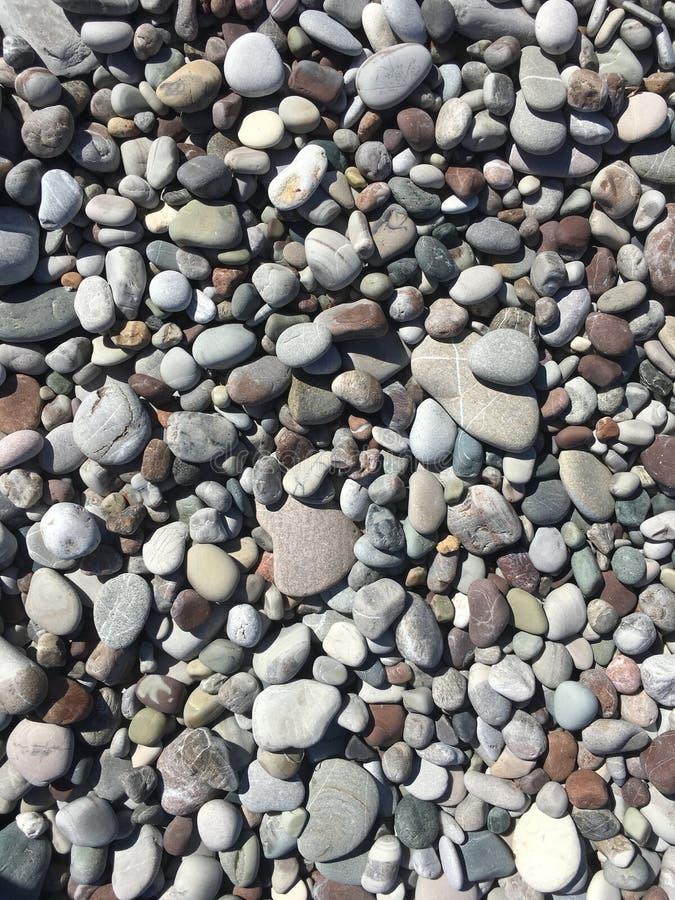 Pebble or shingle beach. coast of the sea. Pebble background. Pebble or shingle beach. coast of the sea stock photo